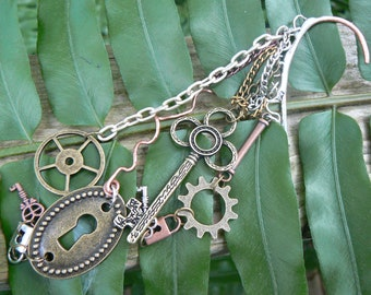 steampunk fantasy ear cuff wrap copper mixed metals keys lock charms in gypsy boho hippie gothic and fantasy style