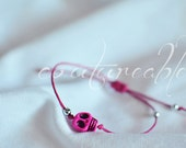 Pink howlite skull bracelet.