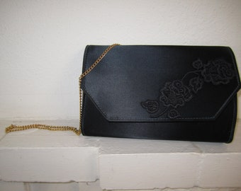Black satin clutch with gold chain strap