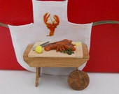 Miniature lobster on  platter with parsley and lemon,  apron  included  Catalogue PM 67
