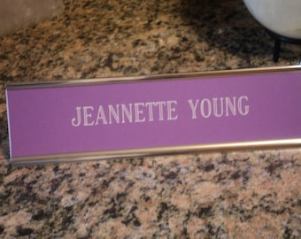 "Custom engraved 2"" x 8"" desk sign purple/white letters - with silver aluminum holder"