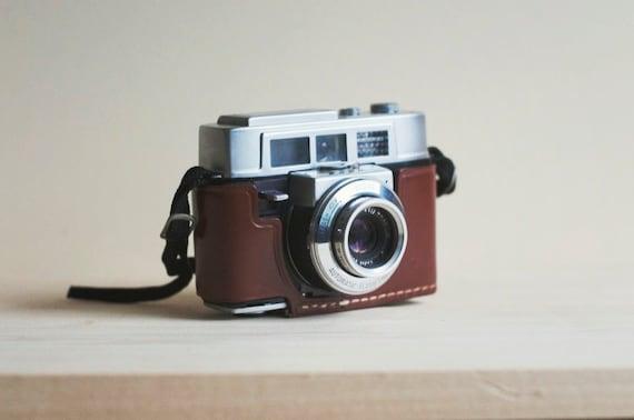 vintage 35mm film camera with beautiful leather case. kodak automatic 35f.