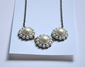 Unique metal & pearl necklace