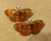pair of mini orange butterfly barrettes