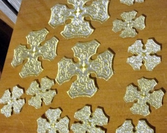 A set of 12 crosses for a set of Orthodox Christian priest's vestments