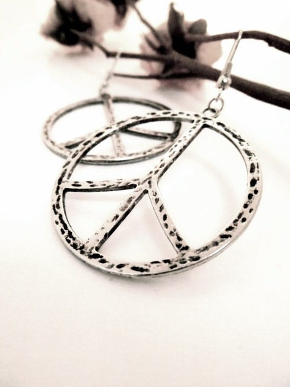 A Swaying Pair of Silver Plated Peace Sign Earrings