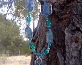 Blue ribbon beaded charm bracelet