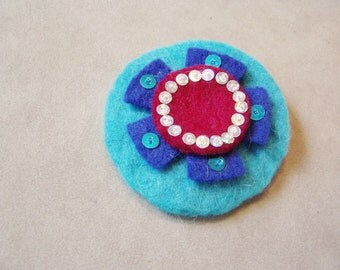 Turquoise and royal blue felt brooch with red berry center and sequins