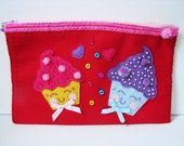 Plush novelty zipper purse with lace and button accents.