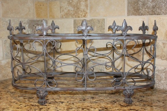 Set of wrought iron, distressed planters/baskets