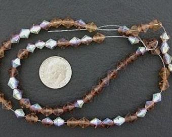 6mm smoky topaz colored bicone ab glass beads