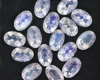 one 6x4 oval faceted rainbow moonstone gemstone stone