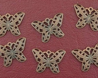 six ornate 22x15 copper butterfly filigree findings
