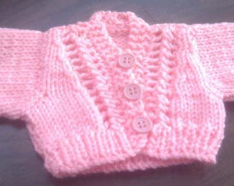 Small pink knitted dolls cardigan