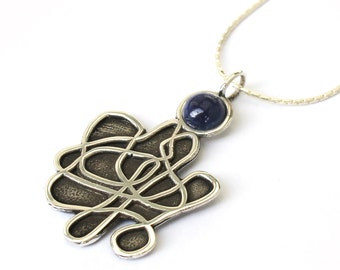 Unusual Tangle Silver Pendant with a Gemstone .