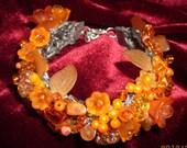 Embroderied bracelet with gemstones