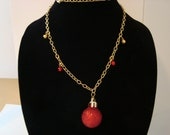 Holiday ornament necklace with jingle bells