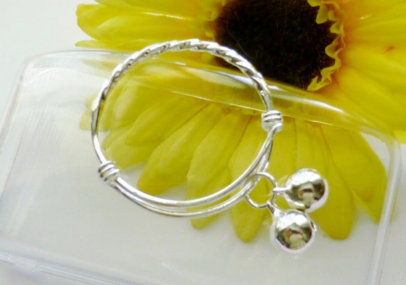 baby silver bangles wave design - pair of bangle bracelets with jingle bell charms