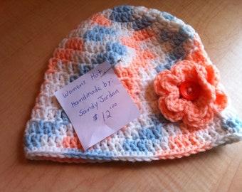 Women's peach/blue variegated hat with peach flower