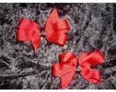 Pair of medium Lady Bug print hair bows