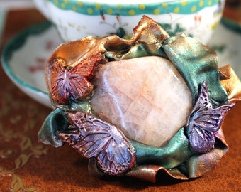 Butterfly Garden - sculpey and quartz brooch