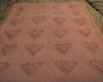 Knitted pink heart baby blanket
