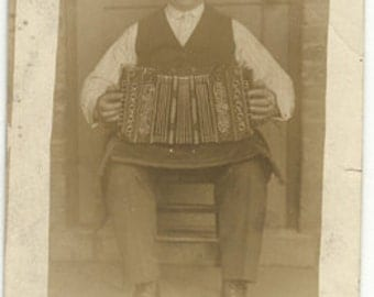 Accordian player instrument music postcard concertina vintage