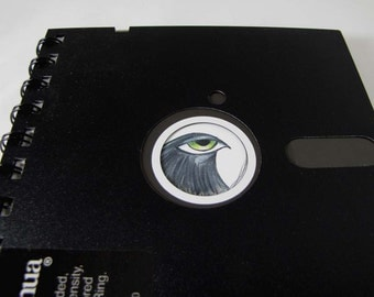 "Recycled Geek Gear Computer Floppy Disk Notebook 5 1/4"" with Reproduction Artwork of a Black Big Eyed Bird"