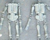 "Earrings Long Jointed Skeletons with Red Jeweled Eyes - 6.5"" Length"
