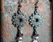 metal tribal earrings with purple bead accents