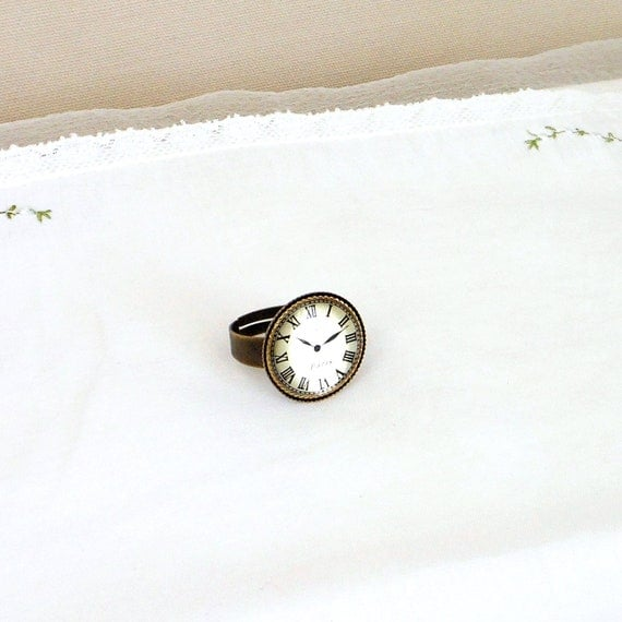 Time travel ring with old world paris clock button