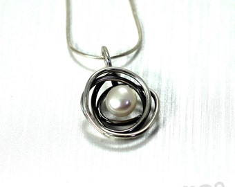 Pendant with twisted swirl wire and white or black pearl , 8-9 mm freshwater pearl and sterling silver