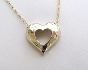 Hammered cutout heart pendant necklace on delicate 14k gold plate chain