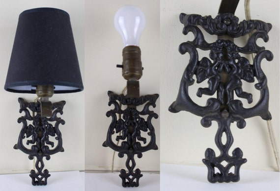 1950s Black Cast Iron Wilton Trivet Wall Sconce With Cherubs