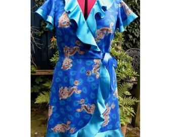 dragon dress - wrap dress in blue chinese dragon print with turquoise satin frills