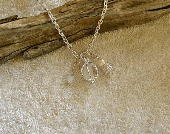 Sea glass locket charm necklace. Sea glass jewelry.