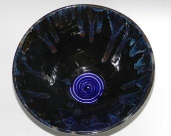 Black ceramic bowl with cobalt blue glaze