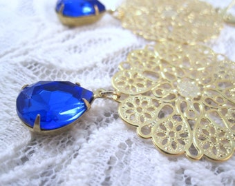 Sapphire and gold statement earrings - blue jewels on gold filigree on leverbacks