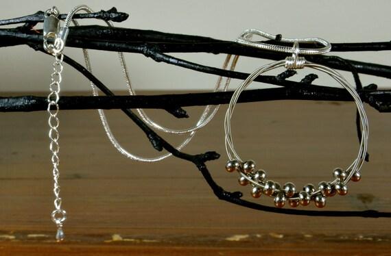 floating melody guitar string necklace. Black Bedroom Furniture Sets. Home Design Ideas
