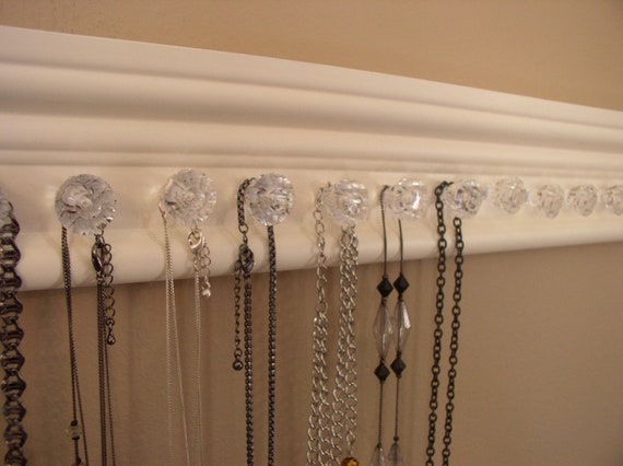 WOW jewelry/ necklace holder with 19 decorative small acrylic  knobs with off white finish 26  inches