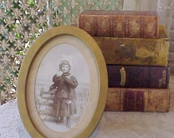 Darling Victorian Era Oval Metal Stand Up Frame with Sweet Sepia Photograph of LIttle Girl