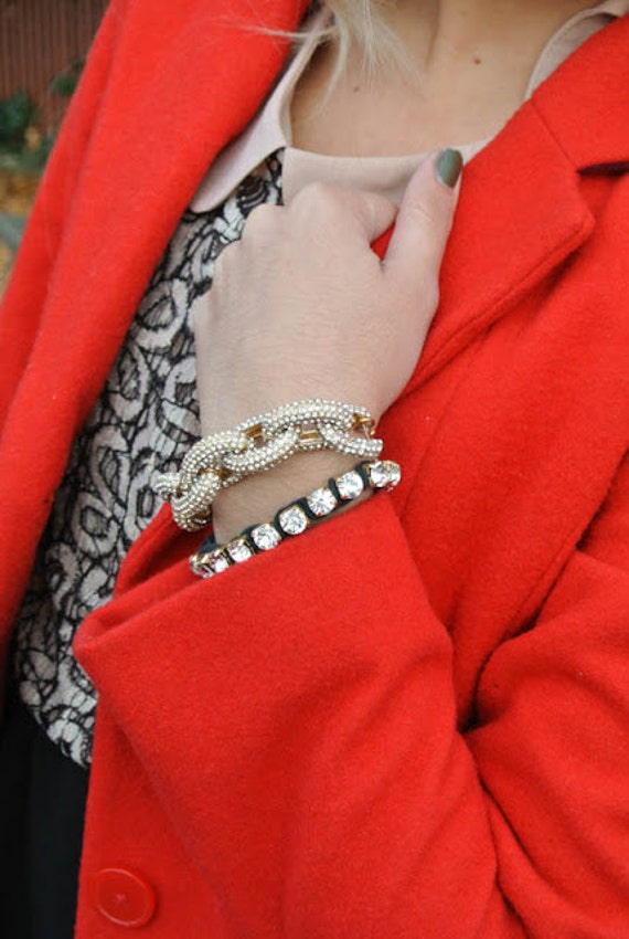 Pave  chain bracelet with monogrammed charm.