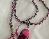 ON SALE Hot Pink Necklace with purple leather and chain intertwined with a pendent made of Agate and a Swarovski crystal.