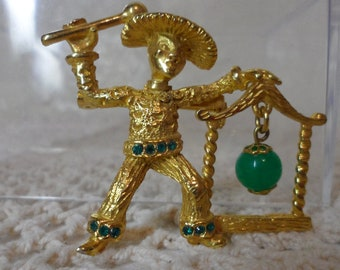 Vintage Costume Jewelry Asian Man Pin with Green Bead Hanging Gong Gold Tone 1960's Green Glass Bead Fun