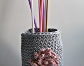 Recycled cotton and acrylic crocheted jar cover in icy blue with pink flower