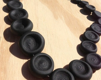 Dimple Necklace in black: deep & richly textured handmade beads create a stimulating piece.