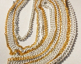 vintage chains a necklace 5 strands white and gold chains 1960s vintage jewelry