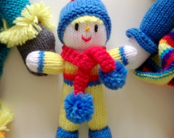 Hand knitted baby scarecrow doll