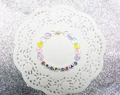 pastel beaded 'DROP DEAD' bracelet - irridescent hearts and pearl beads - cute & sassy