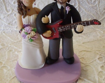 Customized bride and groom with guitar wedding cake topper